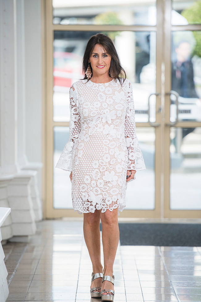 Cindy wearing white Lace with a Bell Sleeve is a hot style this season Dress from Seed Heritage
