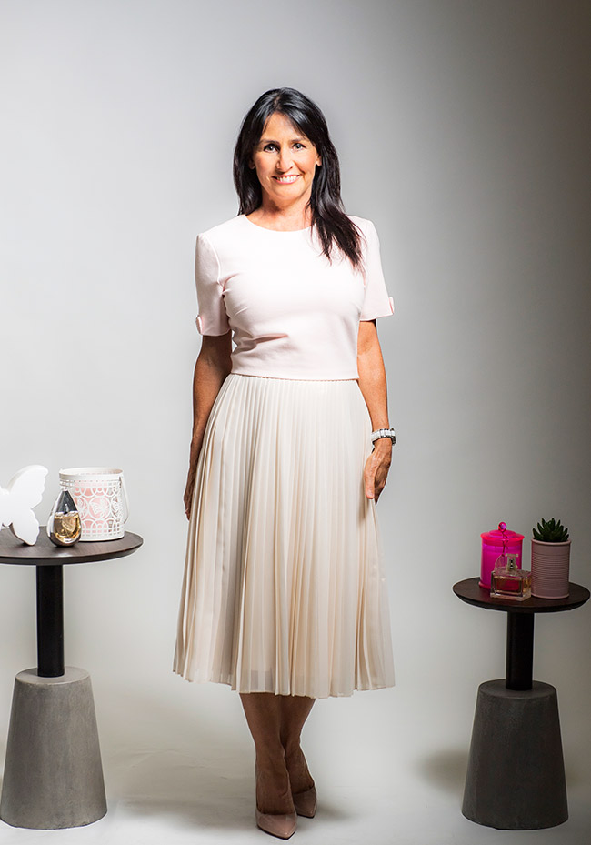 Cindy wearing Ted Baker skirt and Top