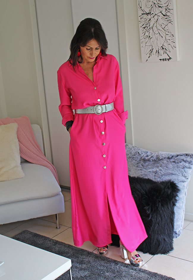 Cindy in a pink floor length dress, silver belt and shoes