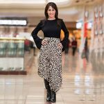 Cindy in a leopard patterned skirt and black top